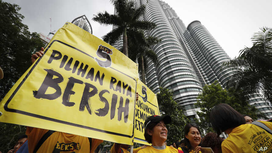 """Activists from the Coalition for Clean and Fair Elections (BERSIH) show a placard reading """"Clean Election BERSIH"""" during a rally in Kuala Lumpur, Malaysia, Nov. 19, 2016."""