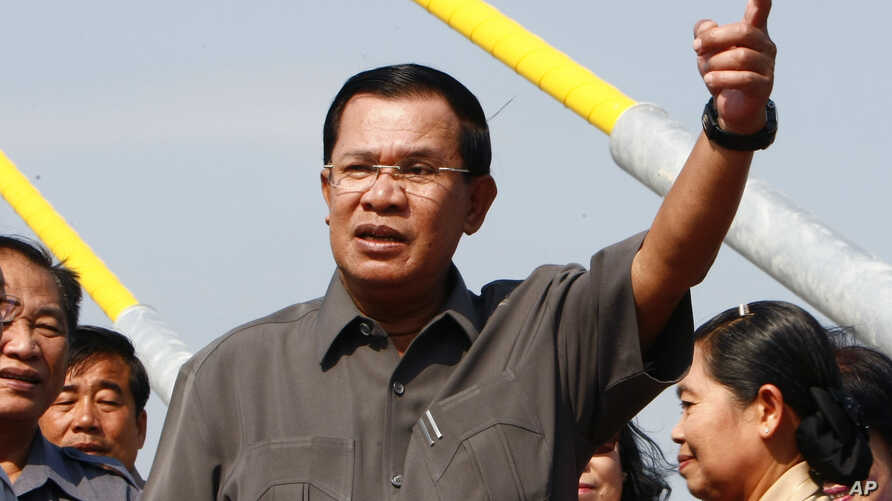 "FILE - Cambodian Prime Minister Hun Sen, delivering a speech in Phnom Penh in January, has called for the country's new National Election Commitee to be independent, saying that it does ""not need to come back and seek guidance from the parties anymor"
