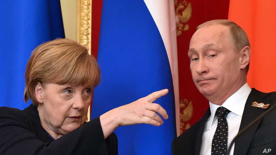 German Chancellor Angela Merkel gestures at a joint news conference with Russian President Vladimir Putin in the Kremlin in Moscow, Russia, Sunday, May 10, 2015.