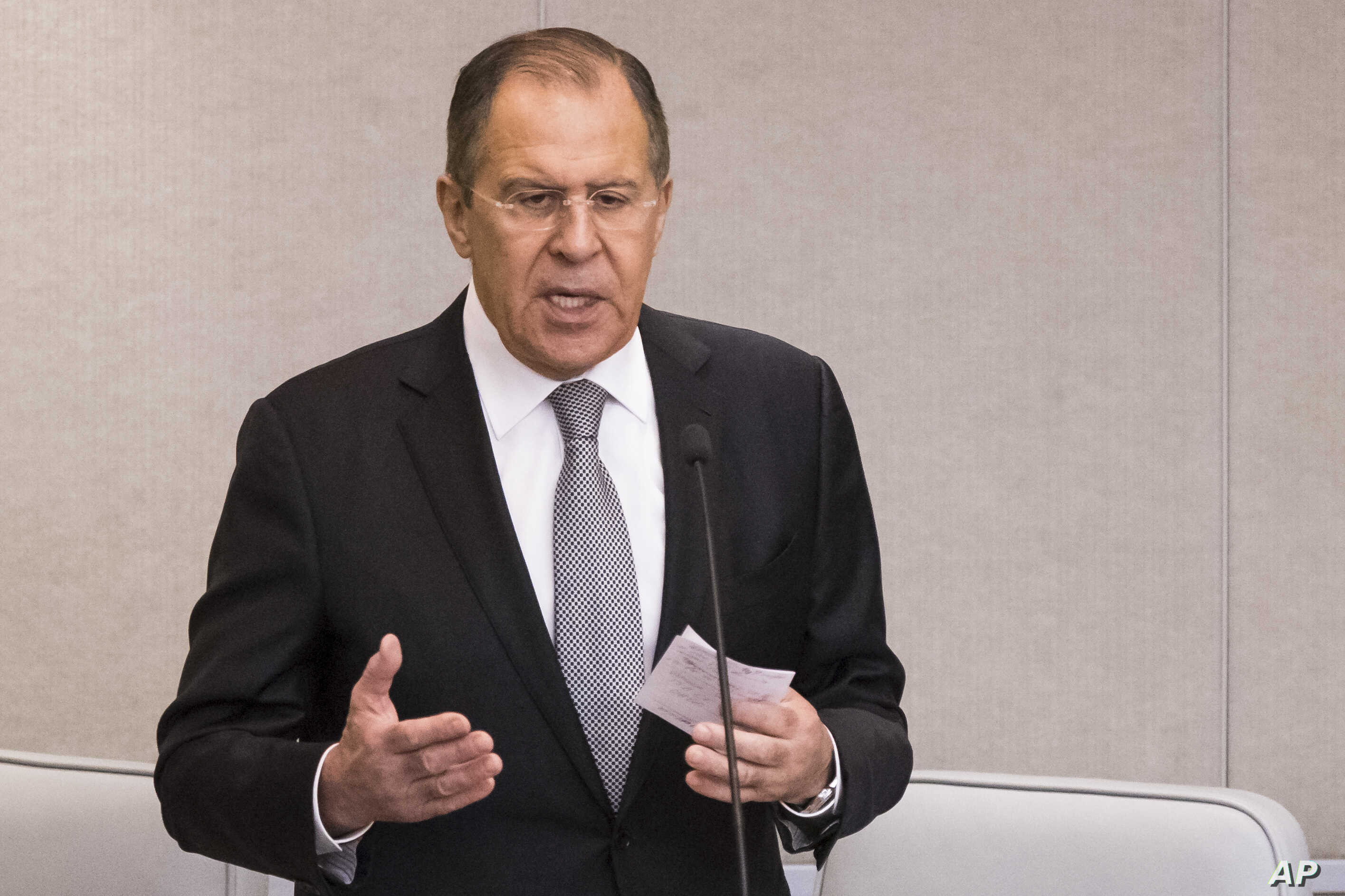 Russian Foreign Minister Sergey Lavrov answers question about peace talks for Syria in the State Duma, lower parliament house, in Moscow, Jan. 25, 2017.