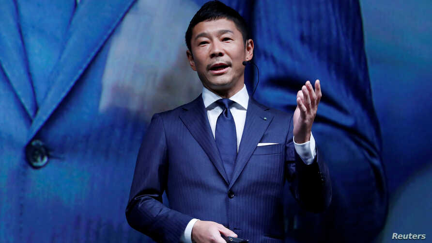 FILE - Yusaku Maezawa, the chief executive of Zozo, which operates Japan's popular fashion shopping site Zozotown and is officially called Start Today Co, speaks at an event launching the debut of its formal apparel items, in Tokyo, Japan, July 3, 20