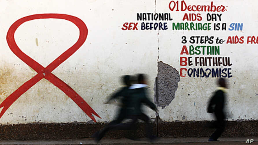 Children run past a mural painting of an Aids ribbon at a school in Khutsong Township, 74 km (46 miles) west of Johannesburg, August 22, 2011.