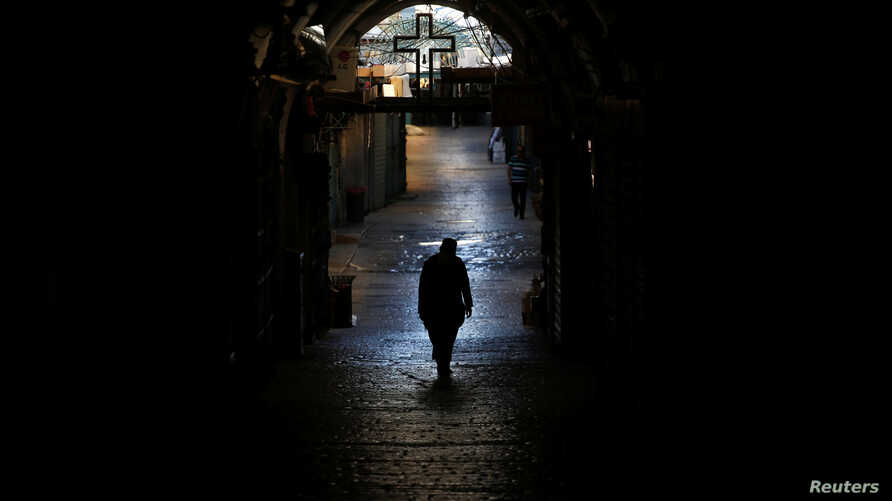 A priest walks in the Christian Quarter of Jerusalem's Old City, June 21, 2016. A recent wave of violence by Muslims on Jews has raised anxiety in the minority Christian community.