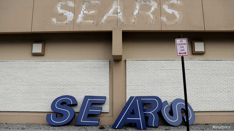 FILE - A dismantled sign sits leaning outside a Sears department store one day after it closed as part of multiple store closures by Sears Holdings Corp in the United States in Nanuet, New York, U.S., Jan/ 7, 2019.