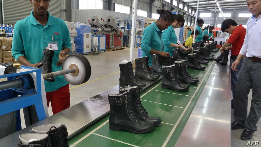 People work on the assembly line at Huajian shoe factory in Dukem, Ethiopia, April 19, 2012.
