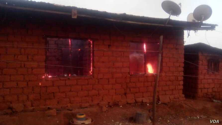 Flames are seen inside a house that allegedly was torched by the military lie in Kumbo, Cameroon. (M. Kindzeka for VOA)