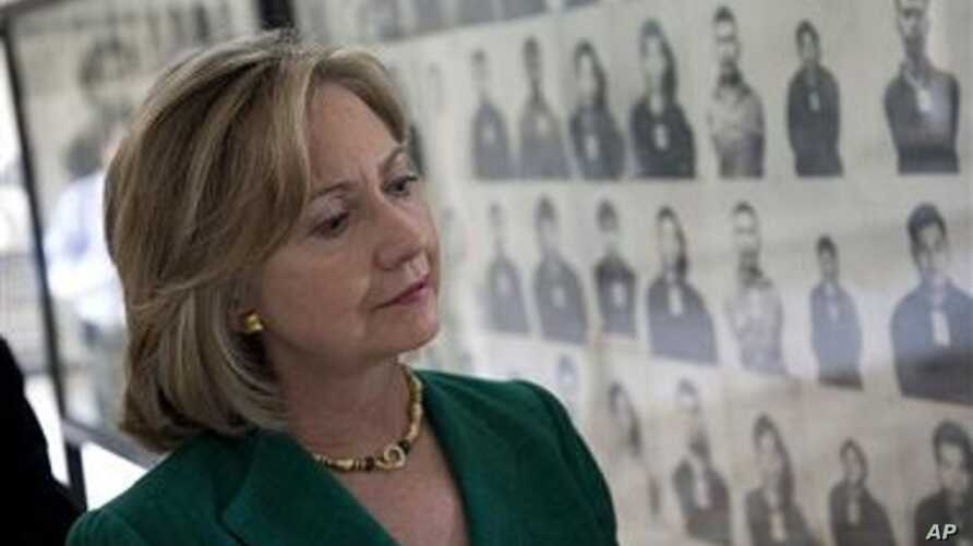 US Secretary of State Hillary Rodham Clinton looks at a wall of faces of those killed by the Khmer Rouge regime, during a tour of the Tuol Sleng Genocide Museum, formerly the regime's notorious S-21 prison,  in Phnom Penh, Cambodia, 01 Nov 2010
