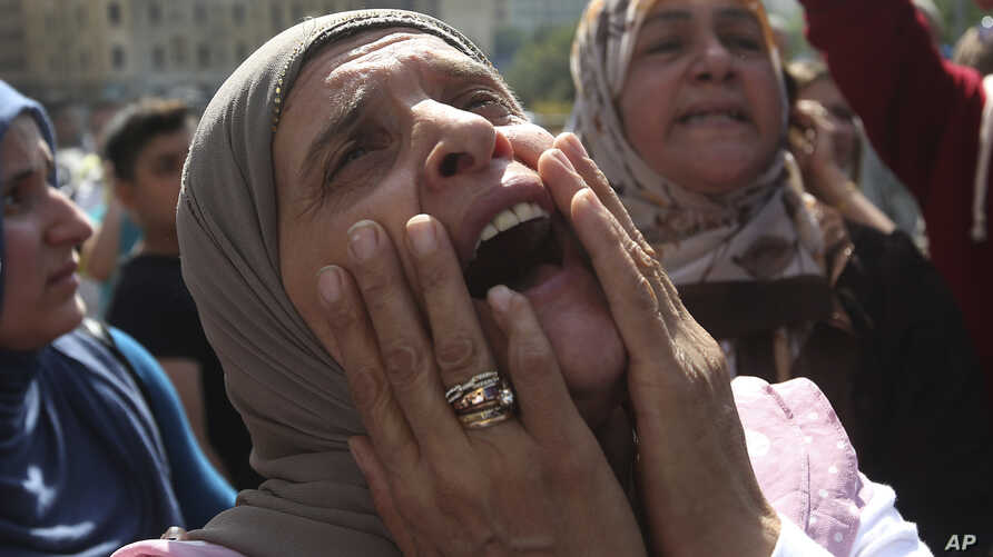 The mother of Abbas Medlej, a missing Lebanese soldier who was kidnapped by Islamic State militants, shouts slogans during a demonstration to demand action to secure the captive's release, in front the Lebanese government building, in downtown Beirut
