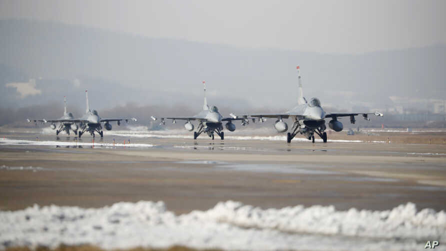 FILE - U.S. Air Force F-16 fighter jets take part in a joint aerial drills called Vigilant Ace between U.S and South Korea, at the Osan Air Base in Pyeongtaek, South Korea.