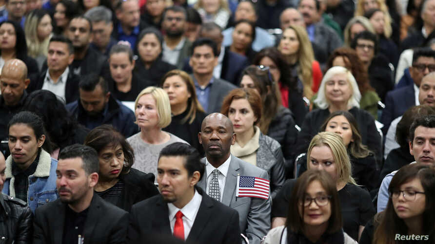 Immigrants participate in a naturalization ceremony to become U.S. citizens in Los Angeles, Dec. 19, 2018.