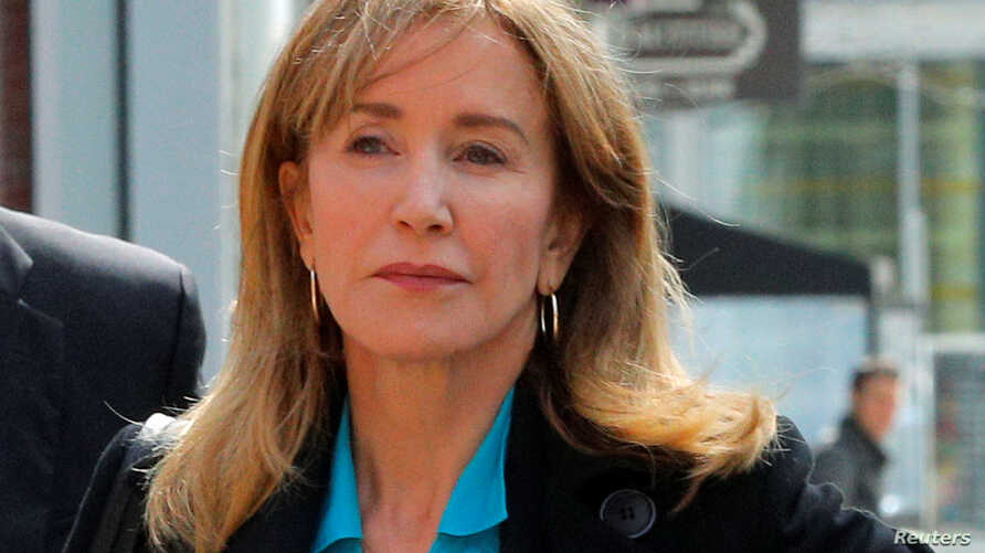Actor Felicity Huffman, facing charges in a nationwide college admissions cheating scheme, enters federal court in Boston, Massachusetts, April 3, 2019.