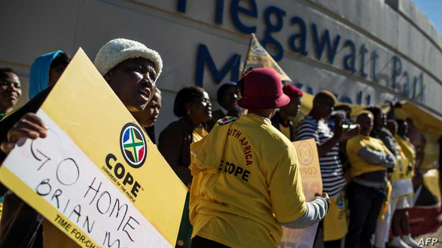 Members of South African political party Congress of the People (COPE) demonstrate outside state entity Eskom Offices at Megawatt Park against the re-instatement of Brian Molefe as Eskom CEO on May 15, 2017.