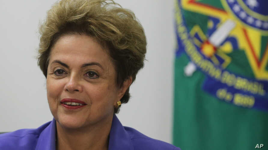 Brazil's President Dilma Rousseff meets with women rural workers at Planalto Presidential Palace in Brasilia, Brazil, Thursday, Aug. 6, 2015.