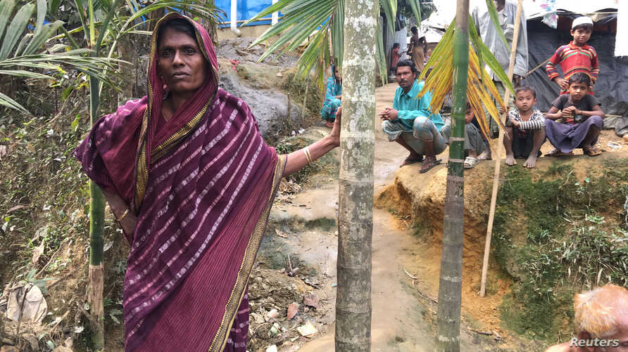 Bangladeshi farmer Jorina Katun stands among the Rohingya Muslims camped out on her land near the Kutapalong refugee camp in the Cox's Bazar district of Bangladesh, Feb. 9, 2018.