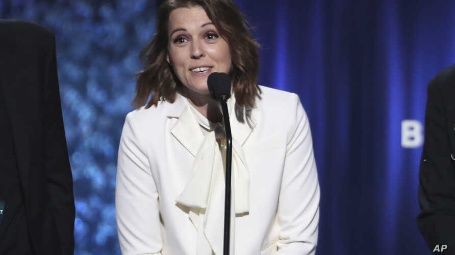 """Brandi Carlile accepts the award for best American roots performance for """"The Joke"""" at the 61st annual Grammy Awards, Feb. 10, 2019, in Los Angeles, California."""