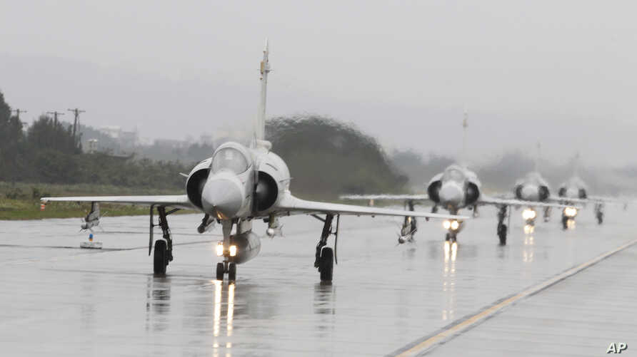 A team of Taiwan Air Force Mirage 2000 fighter jets participate in a military exercise in Hsinchu, northern of Taiwan,  Jan. 16, 2019. Taiwan military started a two-day joint forces exercise to show its determination to defend itself from Chinese thr