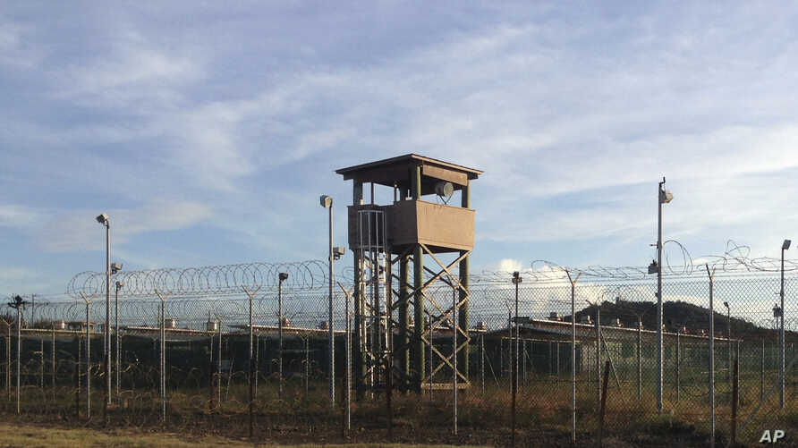 This Dec. 11, 2016 photo shows an unused guard tower at Camp Delta, one of the parts of the detention center at the U.S. Naval base at Guantanamo Bay, Cuba, that is now vacant as the detainee population reaches 59, the lowest it has been since early ...