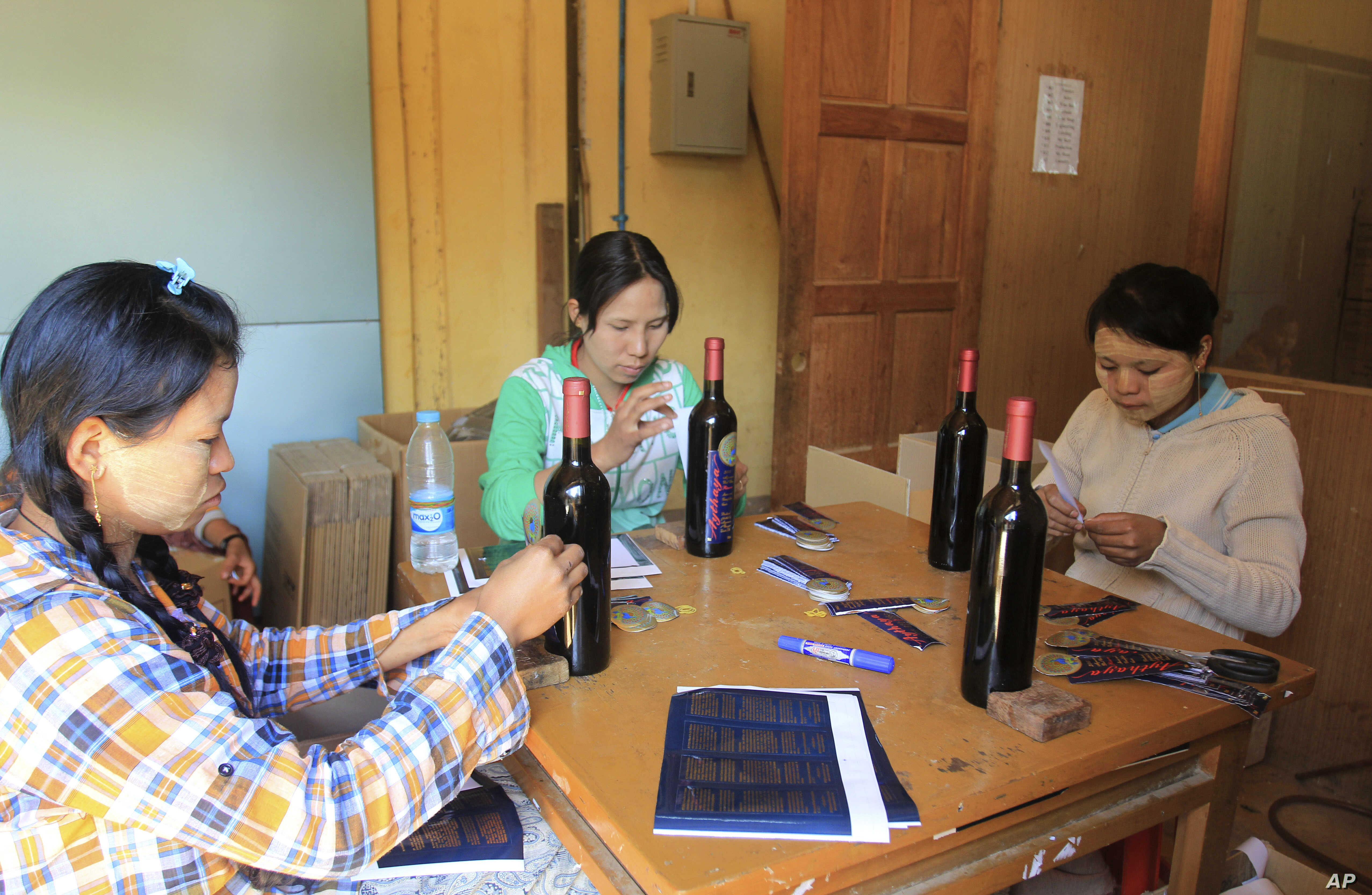 Workers label wine bottles at Aythaya wine estate in Aythaya, near Taunggyi, the capital of northeastern Shan state, Myanmar. Myanmar's first ever winery, a pioneering effort by German entrepreneur, employs about 20-workers daily to maintain the vine