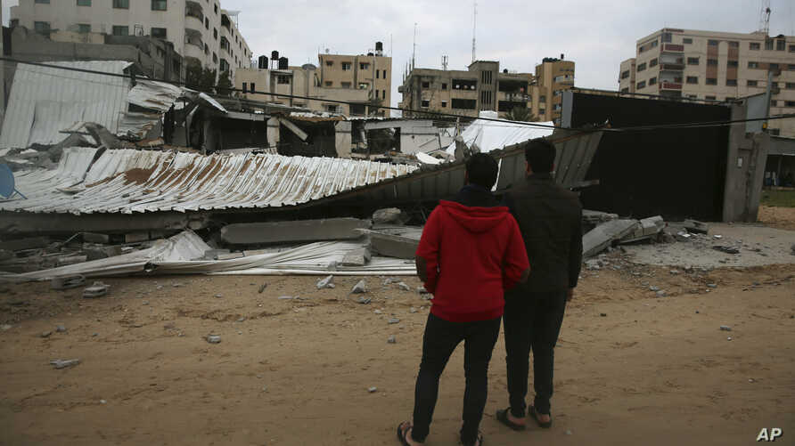 Palestinians check a building belonging to Hamas ministry of prisoners destroyed by Israeli airstrikes in Gaza City, March 15, 2019. Israeli warplanes attacked militant targets in the southern Gaza Strip early Friday in response to a rare rocket atta