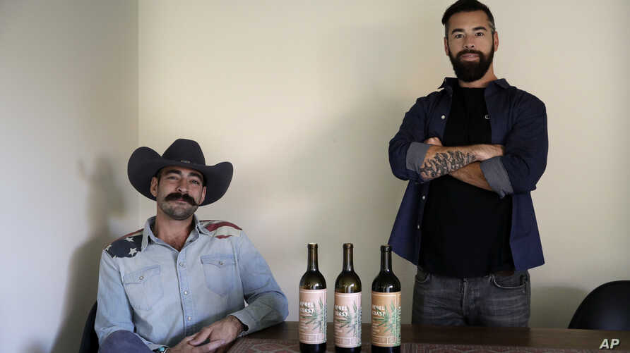 In this Dec. 22, 2017, photo, Alex Howe, right, and Chip Forsythe, co-founders of Rebel Coast, pause for photos with their cannabis-infused wine in Los Angeles.