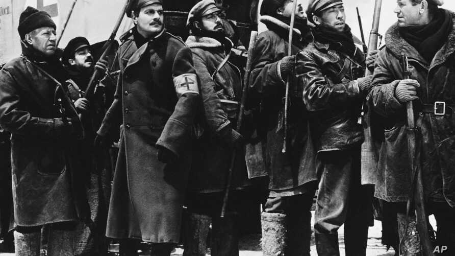 FILE - In this 1`965 image provided by MGM, Yuri Zhivago, played by Omar Sharif (2nd from L), is shown arriving with replacement Russian  troops in a scene from the film 'Doctor Zhivago.'