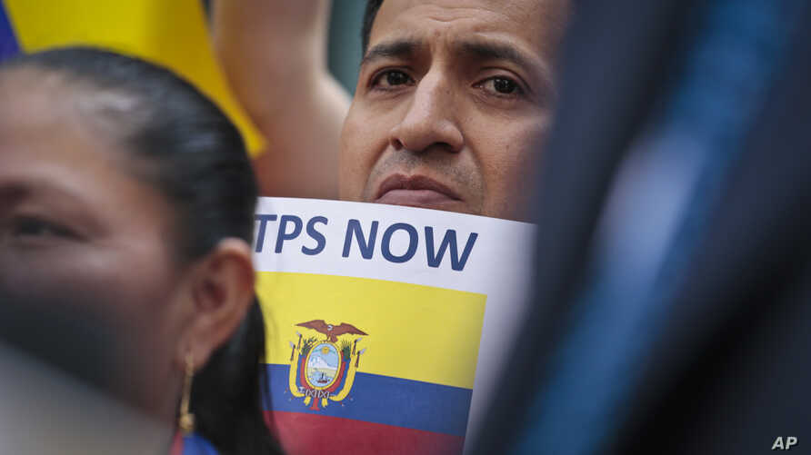 A supporter amongst a coalition of community leaders and immigrant advocates demonstrates outside U.S. immigration offices, calling on federal authorities to designate Ecuador for Temporary Protected Status (TPS) for its nationals in the aftermath of