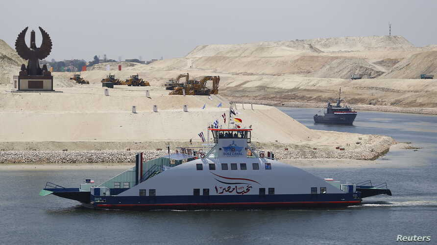 The ship Long Life Egypt crosses a new section of the Suez Canal in Ismailia, Egypt, Aug. 6, 2015. The canal was extended in hopes of powering an economic turnaround.