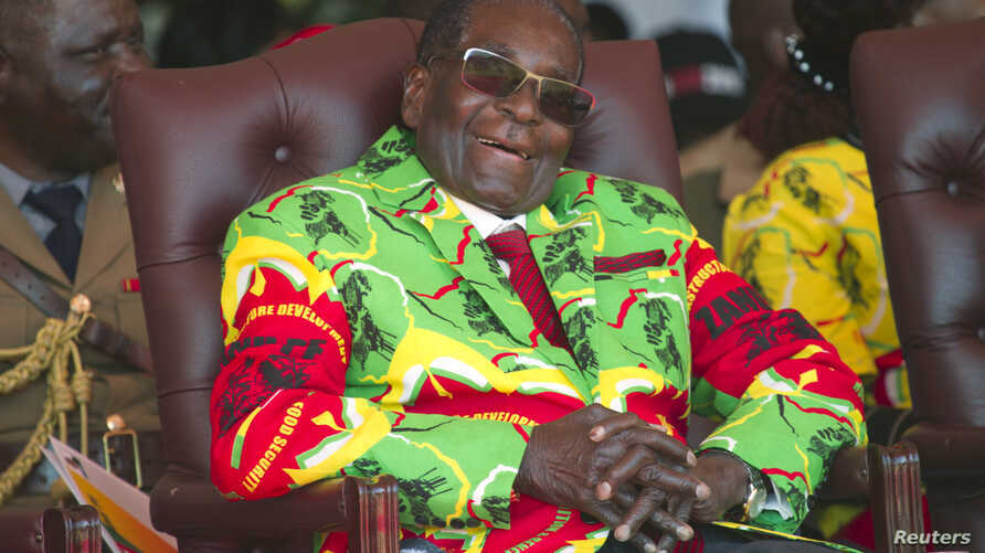 Zimbabwean President Robert Mugabe smiles during a youth rally in Marondera about 100 kilometers east of Harare, June, 2, 2017.