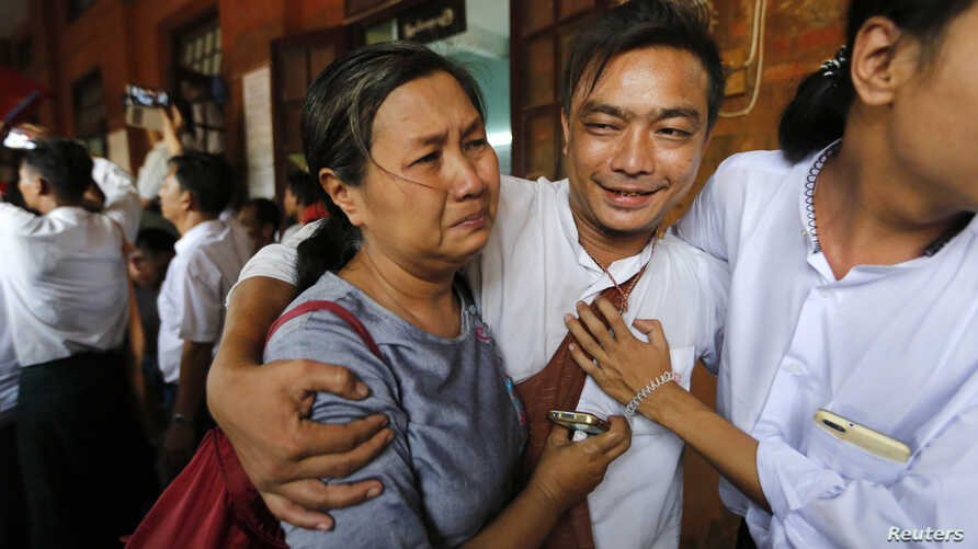 A student protester (C) and his family member cry after he was released by the new government's general amnesty at Tharrawaddy court, Tharrawaddy, Bago division, April 8, 2016.