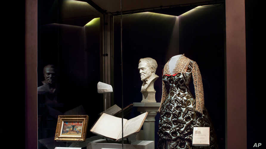 """A display from the """"Giving in America"""" which showcases the role of philanthropy in shaping American civic culture, including museums, libraries, orchestras, universities and hospitalsin seen in Washington, Nov. 23, 2015."""