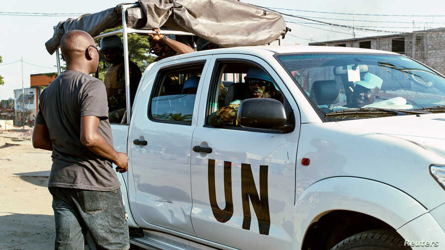 A civilian talks to peacekeepers serving in the United Nations Organization Stabilization Mission in the Democratic Republic of the Congo in Kinshasa, April 10, 2017.