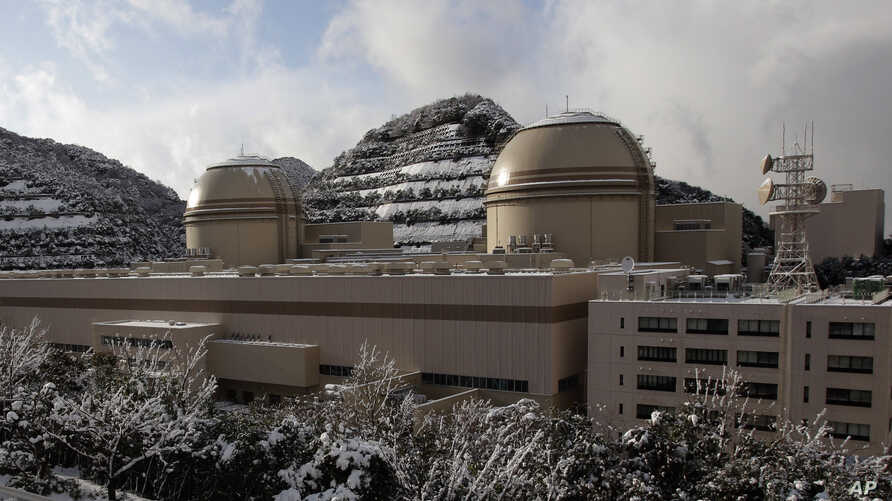 FILE - Kansai Electric Power Co.'s Ohi nuclear power plant No. 3, right, and No. 4 reactors, Ohi, Fukui prefecture, Japan, Jan. 26, 2012. A court ordered the reactor shut down Wednesday, dealing a setback to Prime Minister Shinzo Abe.