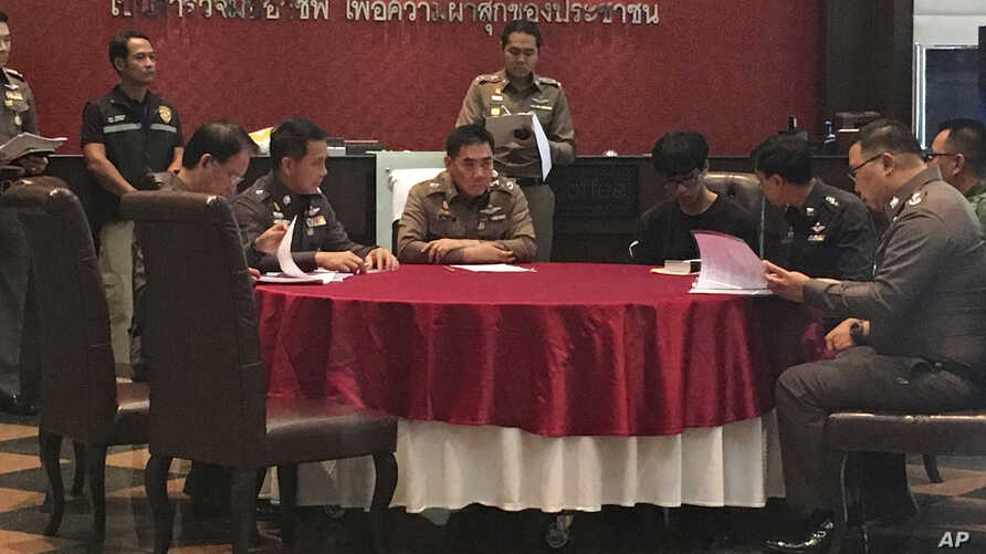 Natdanai Kongdee (3rd from R) is interviewed at the police headquarters in Bangkok, Thailand, Dec 26, 2016.