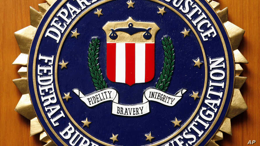 FILE - The Federal Bureau of Investigation of the Department of Justice of the United States of America emblem at the U.S. embassy in Berlin, Aug. 10, 2007.