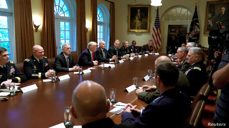 U.S. President Donald Trump participates in a briefing with senior military leaders at the White House in Washington, Oct. 5, 2017.