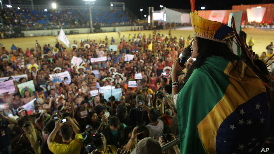 A Xavante indigenous leader speaks out against the approval a proposed constitutional amendment that would put the demarcation of indigenous lands into the hands of the Congress, at the World Indigenous Games in Palmas, Brazil, Oct. 28, 2015, forcing