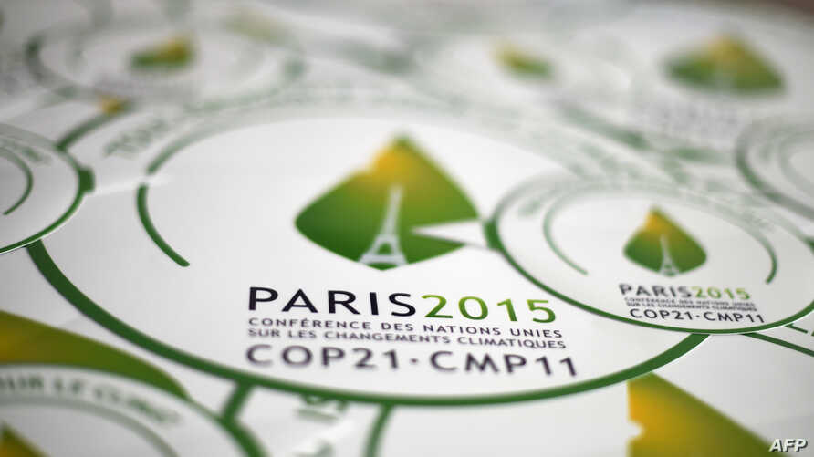 A picture taken on Oct. 30, 2015 shows stickers of the COP21, in Paris, ahead of the Climate Change Conference 2015.