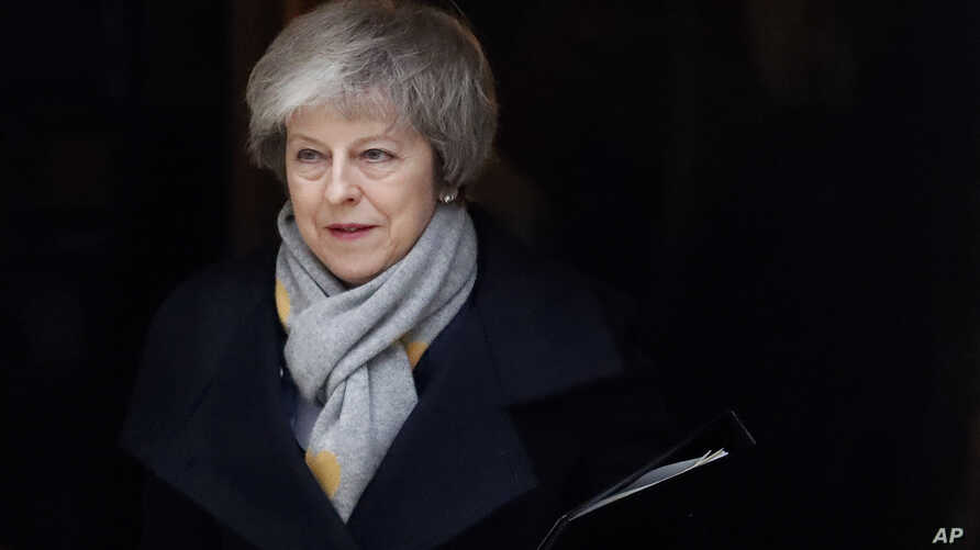 FILE - Britain's Prime Minister Theresa May leaves a cabinet meeting at Downing Street in London, Jan. 15, 2019.