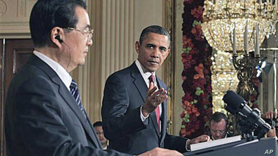 President Barack Obama (r) during a joint news conference with China's President Hu Jintao in the East Room of the White House, 19 Jan, 2011