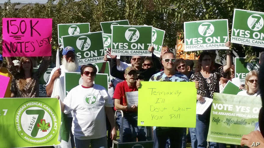 FILE - Supporters of Arkansas Issue 7, a medical marijuana initiative that would have allowed patients with certain conditions an opportunity to obtain or grow marijuana to ease their symptoms, rally outside the Arkansas Supreme Court building in Lit