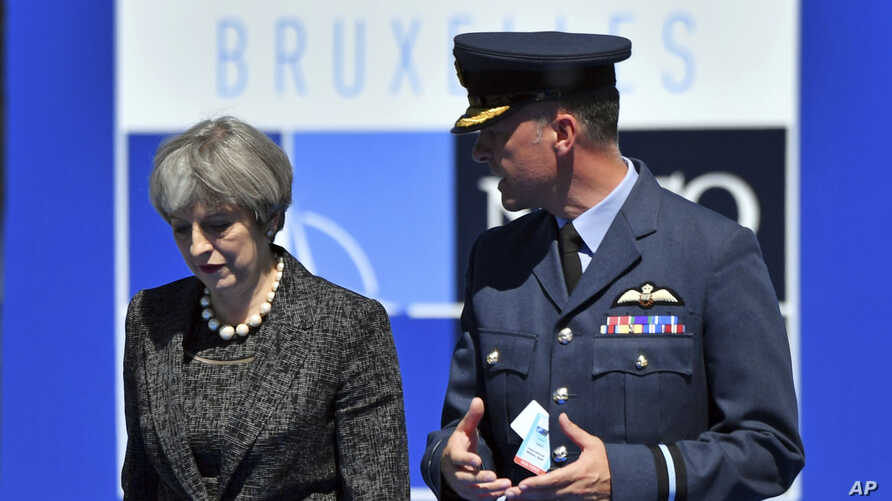 British Prime Minister Theresa May arrives for the NATO summit in Brussels,  May 25, 2017.