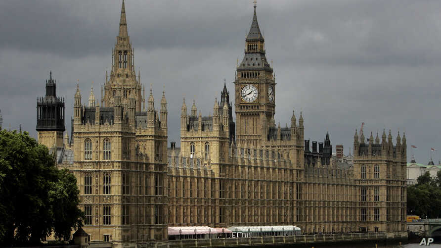 FILE -  A general view of the Houses of Parliament on the river Thames in London.