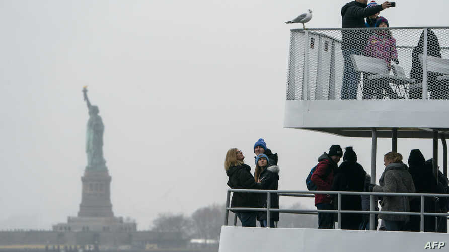 The Statue of Liberty and Ellis Island ferry transports passengers, Jan. 5, 2019, in New York, as the U.S. government shutdown enters its third week. New York state funds are being used to keep the attractions open during the shutdown, which has aff