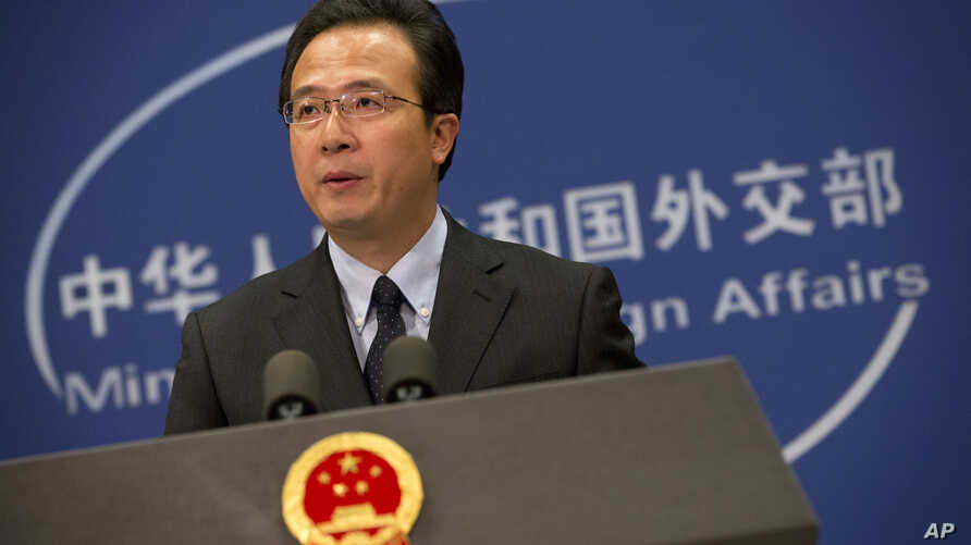 Chinese foreign ministry spokesman Hong Lei speaks during a daily briefing at the Ministry of Foreign Affairs office in Beijing, Nov. 19, 2015.