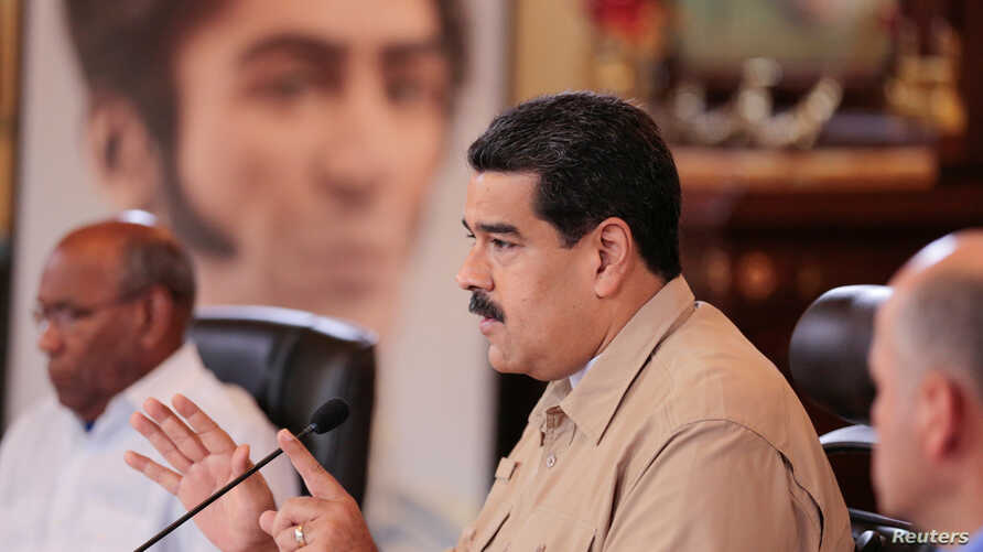 Venezuela's President Nicolas Maduro speaks during a meeting with ministers at Miraflores Palace in Caracas, Venezuela Dec. 1, 2016.