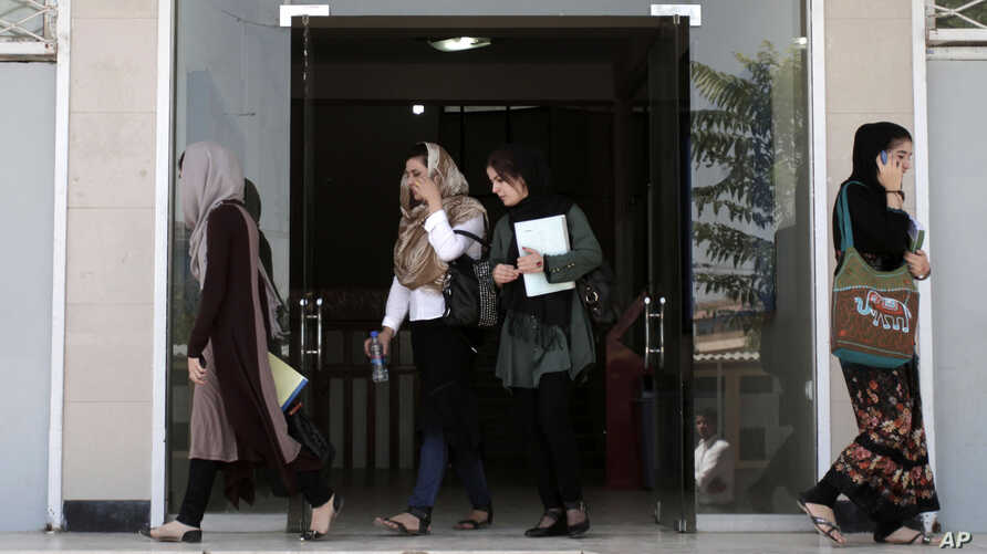 "FILE - Afghan female students leave Kardan University in Kabul, Afghanistan, Sept. 15, 2013. ""By targeting schools, terrorists take aim at a nation's best and brightest, and more broadly at its future,"" one analyst says."