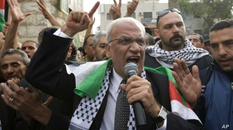 Palestinian chief peace negotiator Saeb Erakat takes part in a demonstration against the Al-Jazeera satellite channel in the West Bank city of Jericho, January 25, 2011