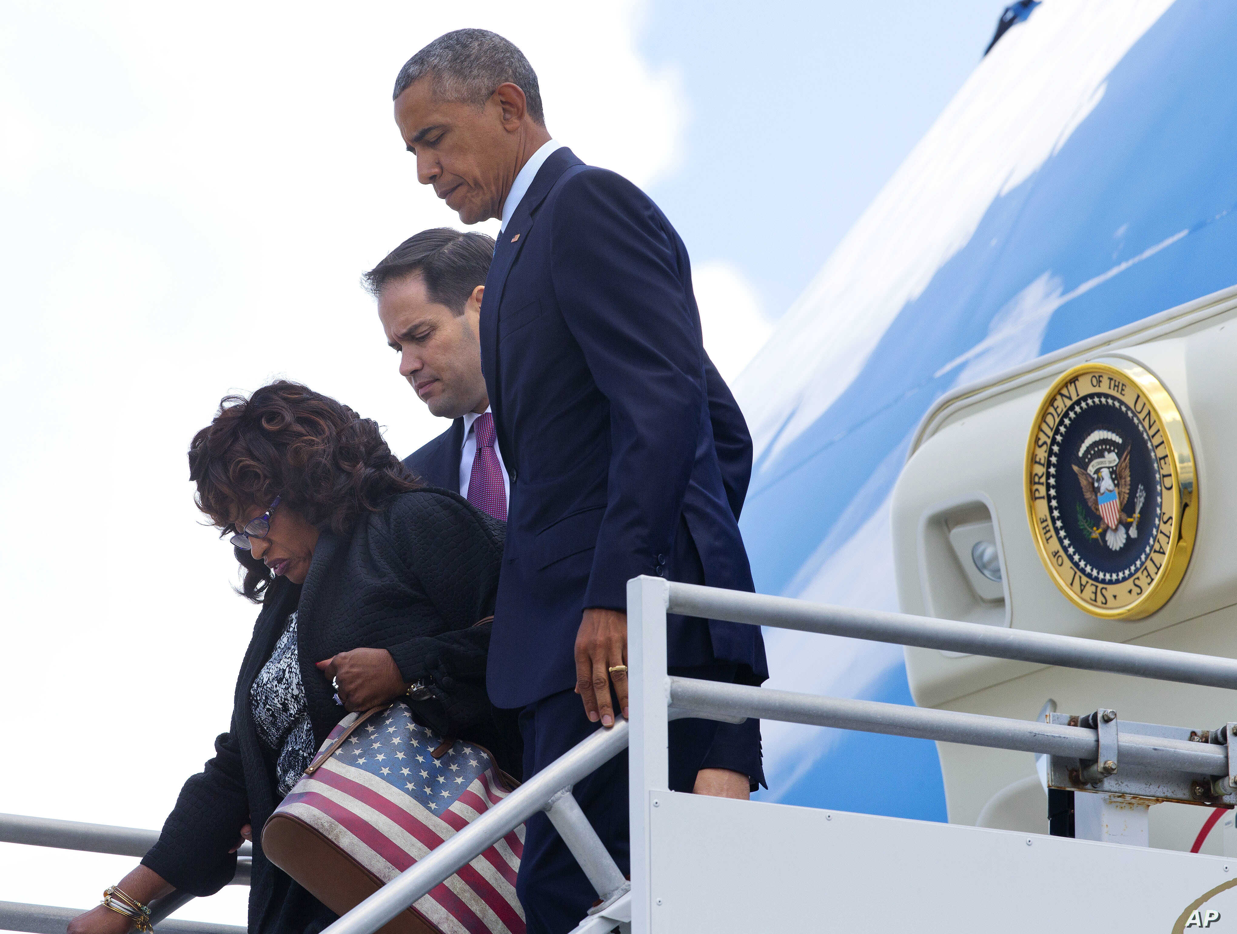 President Barack Obama, with Rep. Corrine Brown, D-Fla., left, and Sen. Marco Rubio, R-Fla.,center, get off Air Force One upon their arrival at Orlando International Airport, June 16, 2016, in Orlando, Fla.