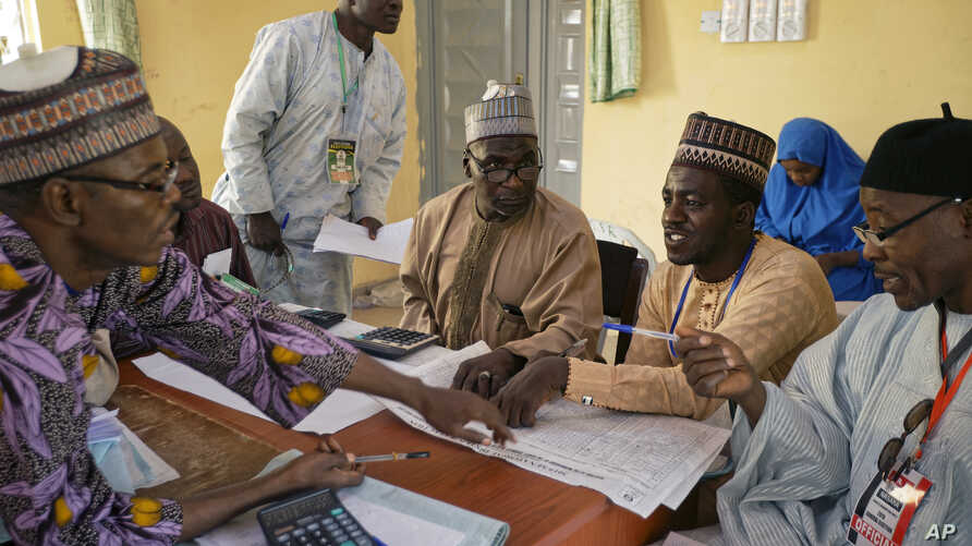 Electoral officials compile voting results at a collation center in Kano, northern Nigeria, Feb. 24, 2019.