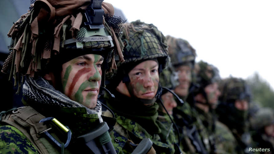 Lithuanian troops along with the other troops from 11 NATO nations take part in an exercise in urban warfare near Pabrade, Lithuania, Dec. 2, 2016.